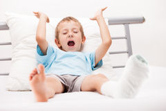 Little child boy with plaster bandage on leg heel fracture or br Stock Photo