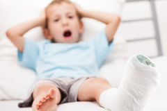 Little child boy with plaster bandage on leg heel fracture or br Stock Images