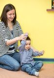 Little child boy playing in kindergarten in Montessori  Class. Royalty Free Stock Photos