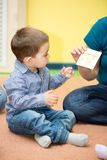 Little child boy playing in kindergarten in Montessori preschool Stock Images
