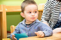 Little child boy playing in kindergarten in Montessori preschool Royalty Free Stock Photos
