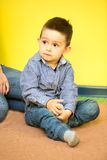 Little child boy playing in kindergarten in Montessori preschool Stock Photo