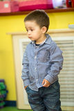 Little child boy playing in kindergarten in Montessori preschool Royalty Free Stock Photography