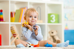 Little child boy plays with toys animals Royalty Free Stock Photo