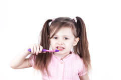 Little child brushes her teeth, isolated on a white background Stock Photography