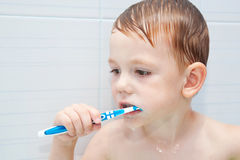 Little child brushing teeth closely. Royalty Free Stock Image