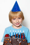 Little child with cap and cake Stock Image