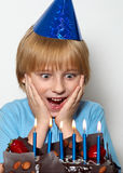 Little child with cap and cake Stock Images