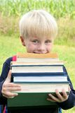 Little Child Carrying Lots of Big Heavy School Books Stock Photos