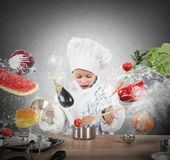 Little child chef. Playing and having fun Stock Image