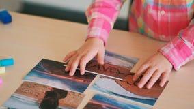 Little child choose best photo travel Stock Images