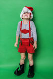 Little child with Christmas dwarf costume Stock Image
