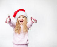 Little child in christmas hat. Child in christmas hat on white background. Happy little girl Stock Images