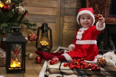 Little child and Christmas toys Stock Photos