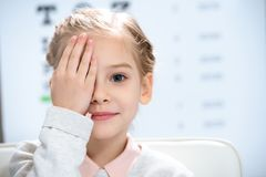 little child closing eye with eye royalty free stock image