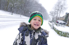Child in snow Stock Images