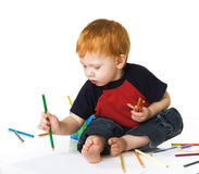 Little child with colour pencils Stock Photo