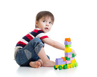 Little child with construction set over white Royalty Free Stock Photo