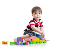 Little child with construction set over white background Royalty Free Stock Images