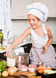Little child cooking soup with vegetables Stock Photo