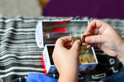 Saving money. Little Child  counting money coins Royalty Free Stock Photos