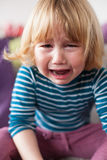Little child crying sitting Stock Images