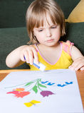 Little child deals with creativity Stock Photography
