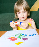 Little child deals with creativity Royalty Free Stock Image