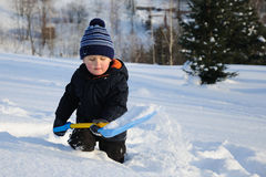 Little child in deep snow Stock Photos