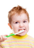 Little child with dental toothbrush brushing teeth Royalty Free Stock Photos