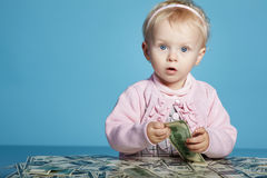 Little child with dollars on table Royalty Free Stock Photo