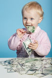 Little child with dollars on table Royalty Free Stock Photography