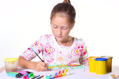 Little child drawing. On a white background royalty free stock photography
