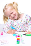 Little child drawing Stock Images