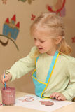 Little child drawing. Smiling little blonde child drawing stock images