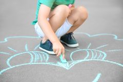 Little child drawing with chalk Stock Image