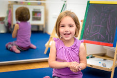 Little child is drawing with color chalk on the chalk board Stock Photo