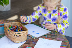 Little child drawing. A pastel on paper stock images
