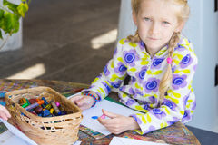 Little child drawing. A pastel on paper royalty free stock photo