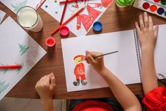 Little child drawing picture at table,. Top view. Christmas celebration stock photos