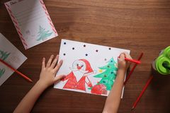 Little child drawing picture at table, top view. Christmas celebration royalty free stock images