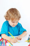 Little child draws with color pencils Royalty Free Stock Photography
