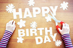 Little child dreaming about birthday celebrations Stock Image