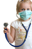 Little child dressed as doctor. Little child plays doctor with stethoscope and mask Royalty Free Stock Images