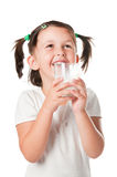Little child drinking milk Stock Images