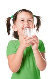 Little child drinking milk Stock Photos