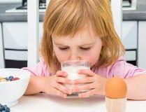 Little child drinking milk Royalty Free Stock Photo