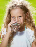 Little child drinking water Royalty Free Stock Images