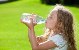 Little child drinking water Royalty Free Stock Photography