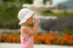 Little child drinking water from glass Stock Photo